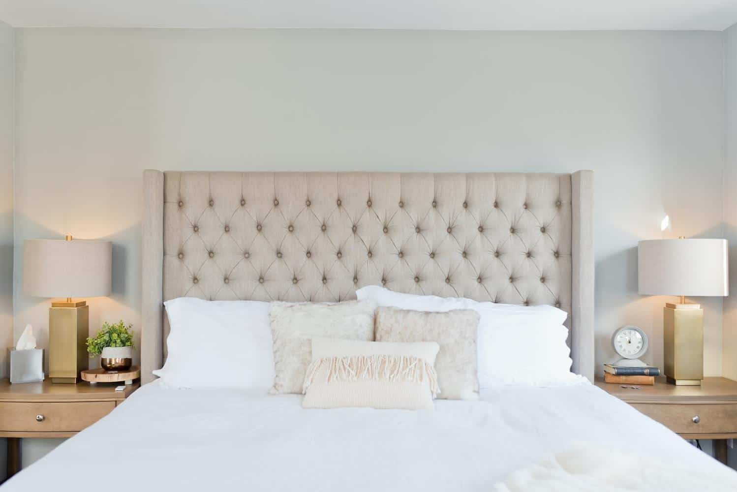 bed with cream headboard